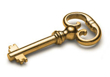 Old Gold Key. An old gold skeleton key isolated on white Stock Photo