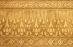 Old Gold Metal Plate with Thai Traditional Carving. In Contemporary style Royalty Free Stock Photography