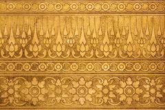 Old Gold Metal Plate with Thai Traditional Carving. In Contemporary style Stock Images