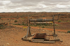 Old gold mine with the winch. In australia desert Royalty Free Stock Photo