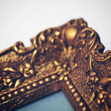 Old gold picture frame. Detail of an antik gold picture frame Stock Images