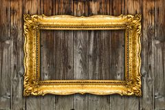 Old Gold Picture Frame on wood background, white inside mockup royalty free stock photography