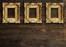 Old Gold Picture Frames on wooden wall Royalty Free Stock Photos