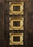 Old Gold Picture Frames on wooden wall Stock Images