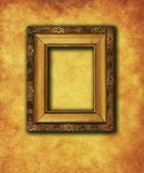 Old gold plated frame on grunge wall Stock Photography