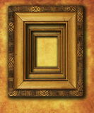 Old gold plated frame on grunge wall Stock Images