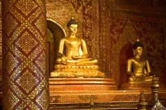 Old Gold sit Buddha inside chruch  Royalty Free Stock Images