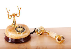 Old gold telephone from onyx. Royalty Free Stock Photo