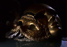 Old gold Venetian masks Royalty Free Stock Images