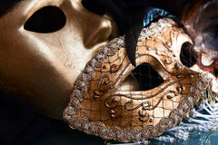 Old gold Venetian masks Stock Photo