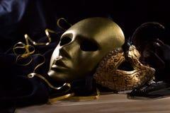 Old gold Venetian masks Stock Image