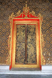 Golden carved doors of Thai temple Royalty Free Stock Images