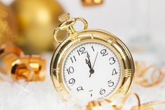 Old golden clock close to midnight and Christmas decorations Royalty Free Stock Photos