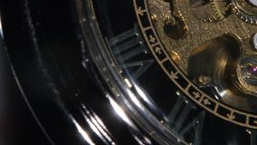 Old golden clock mechanism working. Close up stock footage