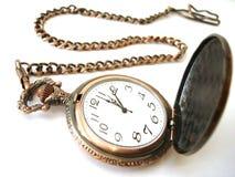 Old golden clock on white Stock Photo