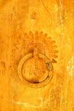 Old golden door knocker Royalty Free Stock Photo