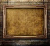 Old golden frame. Old frame on wooden background Stock Images