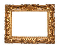 Old golden frame. Ornamented, very old, gold plated empty picture frame for putting your pictures in Stock Images