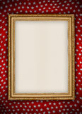 Old golden frame. On red background Stock Photo