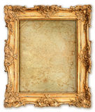 Old golden frame with empty grunge canvas Stock Images