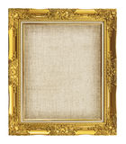 old golden frame with empty grunge linen canvas for your picture Royalty Free Stock Images