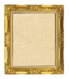 Old golden frame with empty grunge linen canvas for your picture. Photo, image. beautiful vintage background Stock Photo
