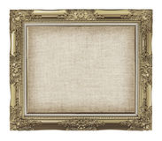 Old golden frame with empty grunge linen canvas for your picture. Photo, image. beautiful vintage background Royalty Free Stock Image