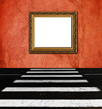 Old golden frame on plaster background Royalty Free Stock Image