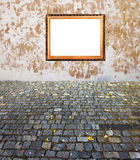 Old golden frame wall and pavement. Old russian style vintage golden frame on old time grunge background wall old stone blocks and maple leaves strong concept Royalty Free Stock Images