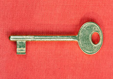Old golden key to the door Royalty Free Stock Images