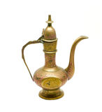 Old golden metallic kettle. With ethnic ornaments royalty free stock photos