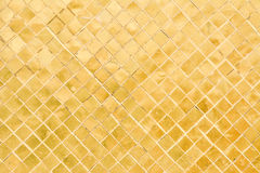 Old golden mosaic wall. Close-up of old golden mosaic wall Stock Images
