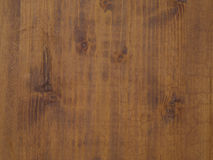 Old golden pine wooden desk with annual circles. And gnarls Royalty Free Stock Photography
