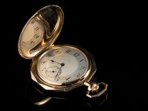 Free Old Golden Pocket Watch On A Black Reflective Surface Stock Photography - 120412812
