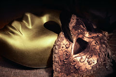 Golden venetian masks Royalty Free Stock Photo