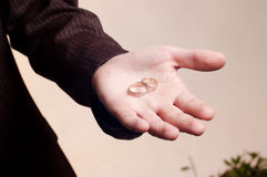 Old golden wedding rings on man's hand Stock Photography