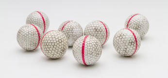 Old golf balls. Old golf balls on white background Royalty Free Stock Photography