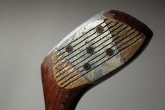 Old Golf Club. On grey background Royalty Free Stock Photos