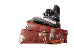 Old good boots at vintage suitcase Stock Images