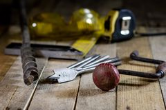 Old good carpentry, tools drill bit. Wooden carpentry table and. Old good carpentry tools on it. Black background Royalty Free Stock Photos