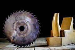 Old good carpentry, tools drill bit. Wooden carpentry table and. Old good carpentry tools on it. Black background Stock Photos