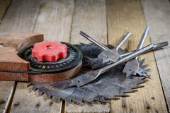 Old good carpentry, tools drill bit. Wooden carpentry table and. Old good carpentry tools on it. Black background Stock Images