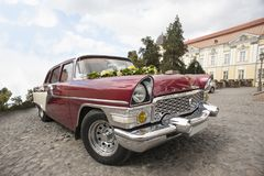 Old, good looking retrocar standing on the street. Stock Photography