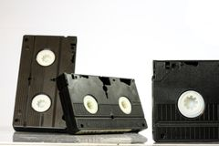 Old good video cassettes. Dusty family recordings on solid data. Carriers, white isolated background Stock Photo