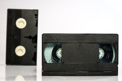 Old good video cassettes. Dusty family recordings on solid data Royalty Free Stock Photo