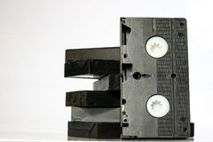 Old good video cassettes. Dusty family recordings on solid data. Carriers, white isolated background Royalty Free Stock Photography