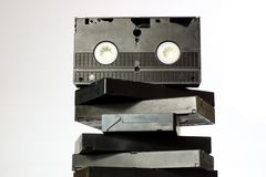 Old good video cassettes. Dusty family recordings on solid data. Carriers, white isolated background Royalty Free Stock Photo