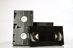 Old good video cassettes. Dusty family recordings on solid data. Carriers, white isolated background Stock Image