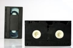 Old good video cassettes. Dusty family recordings on solid data Royalty Free Stock Photography
