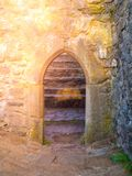 Old gothic arc gate in medieval stone castle ruin.  Stock Images